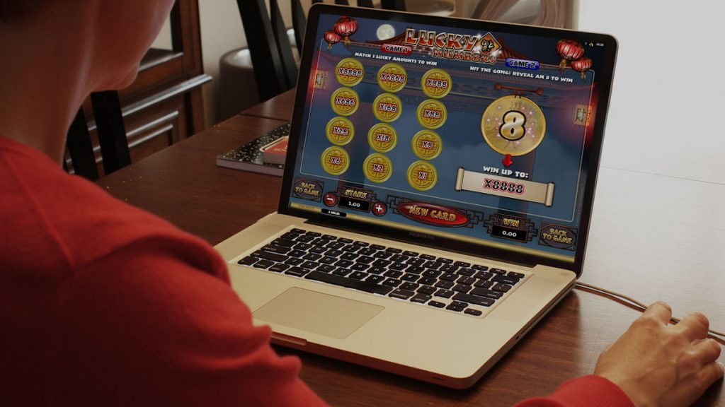 Man Playing Real Money Online Scratch Card Game