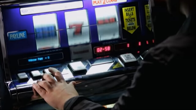 Person Playing on a Slot Machine